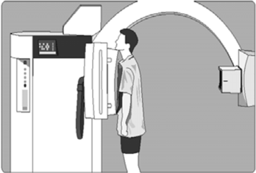 An image showing a patient in a chest X-Ray machine